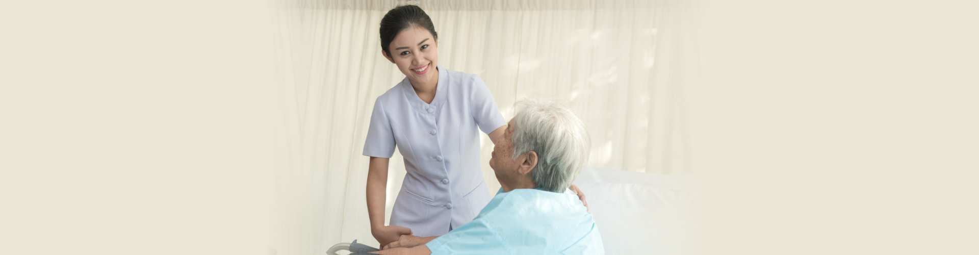 Caregiver attending to elderly woman